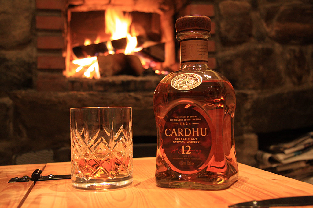 Relax with a glass of single malt whiskey by the fireside...